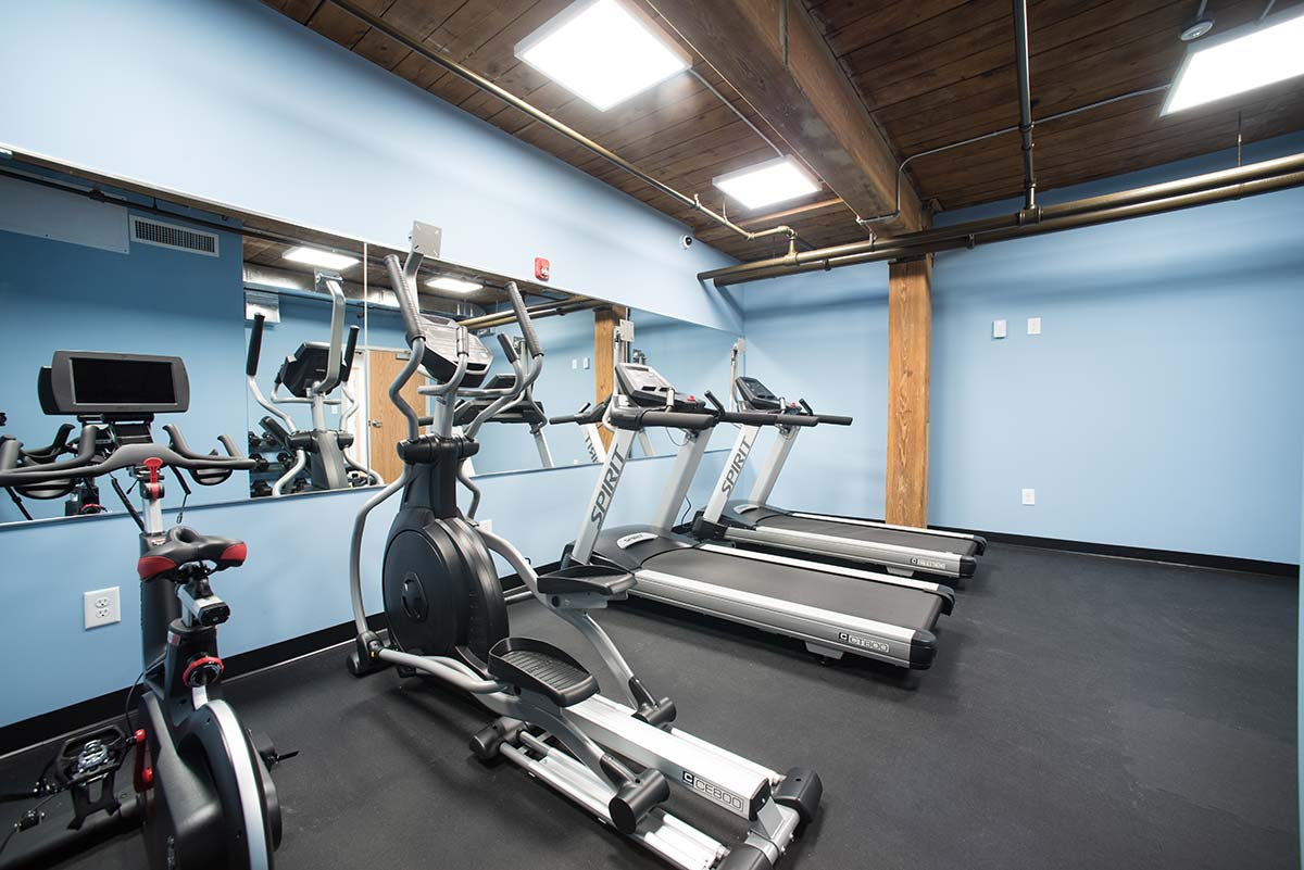 Basement Fitness Center treadmills, elliptical, and spin bike